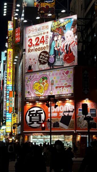 Anime and manga ads on the houses in Akhihabara