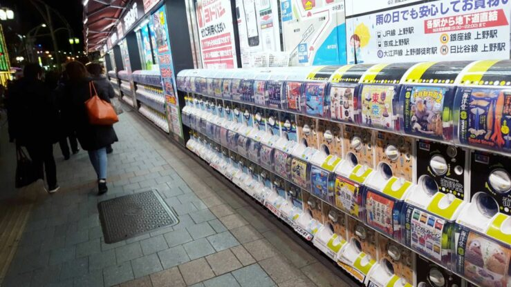 Rows of gachapon vending machines flank the street outside the otaku stores.